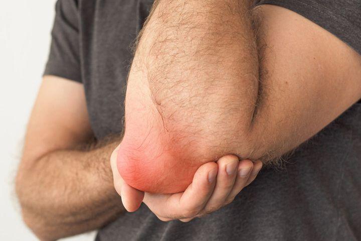 Tennis elbow causes symptomes traitements